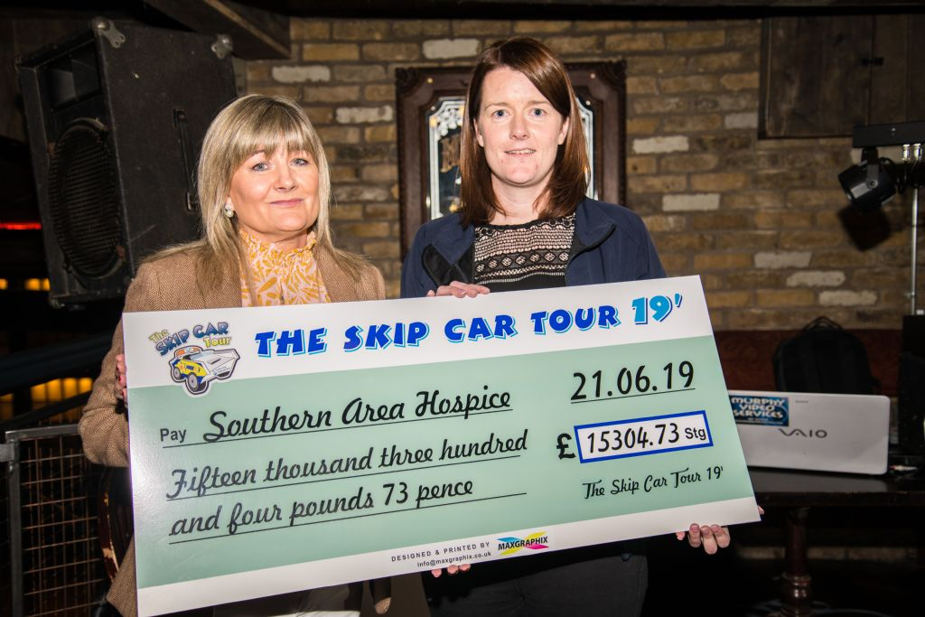 teresa mcardle presenting a cheque to anne mac oscar from the southern area hospice